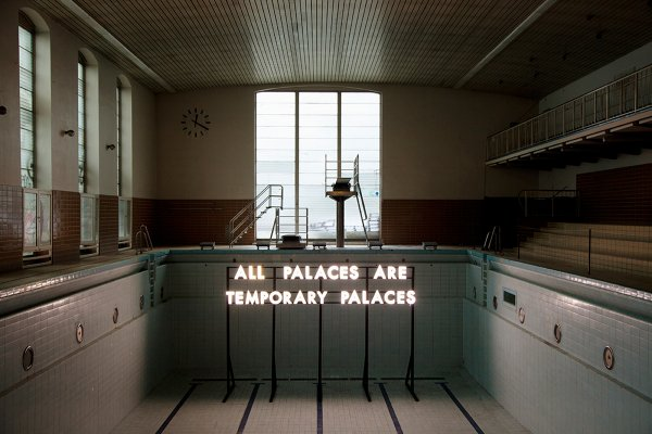Robert Montgomery's artwork All Palaces are Temporary Palaces, seen here installed at Stattbad in Berlin, is especially poignant after the recent closure of the vibrant venue for Berlin's various subcultures. The abandoned swimming pool turned music, arts and creative workspace operated in its renewed capacity for six years. Photo: Kai von Rabenau, Courtesy of Neue Berliner Räume.