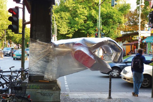 Bosso Fataka make urban art with a sense of humor. Shaking Hands on a Berlin street. hoto: Courtesy of the artists