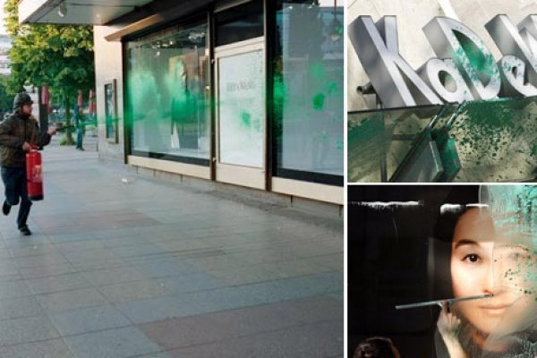 Downey in action spraying Berlin's premier department store with green paint in 2008. Photo: Richard Schwarz